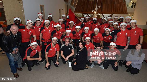 In this handout image from Liverpool FC, All of Liverpool Football Club pose for a photograph before the visit at Alder Hey Children's Hospital on...