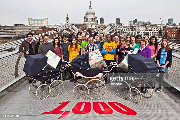 In this handout image from Oxfam participants pose on the Millennium Bridge following a two week 300 mile pram journey that travelled from Manchester...