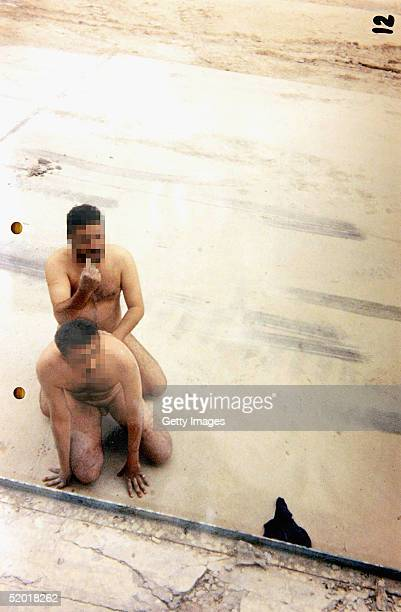 In this handout image from the British Court Martial number twelve of twenty two photographs which were taken from cameras belonging to five...