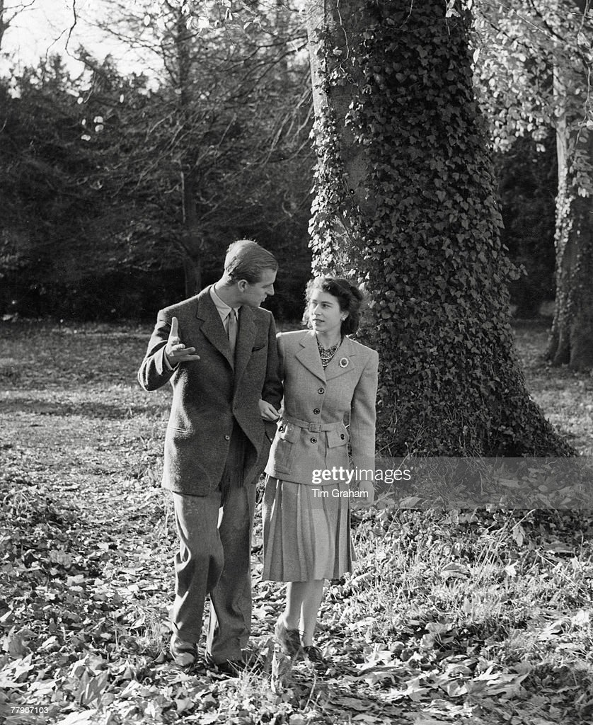 In this handout image from the Royal Collection, made available November 18, 2007, Princess Elizabeth and The Duke of Edinburgh walking in the grounds of Broadlands, the home of the Duke's uncle, Earl Mountbatten, on their honeymoon, circa November 1947.