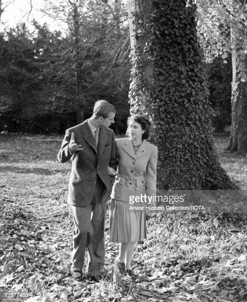 In this handout image from the Royal Collection made available November 18 Princess Elizabeth and The Duke of Edinburgh walking in the grounds of...