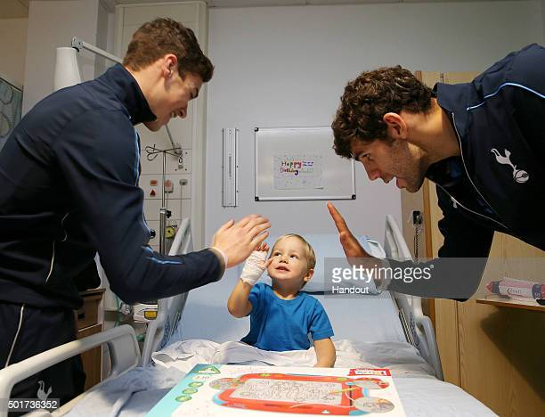In this handout image from Tottenham Hotspur Harry Winks and Federico Fazio hand out presents to patients at North Middlesex hospital on December 17...