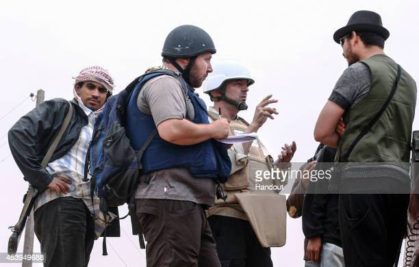 In this handout image made available by the photographer American journalist Steven Sotloff talks to Libyan rebels on the Al Dafniya front line 25 km...