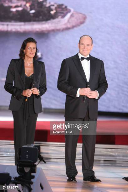 In this handout image Princess Stephanie and Prince Albert II of Monaco speak during the 'Tenue de Soiree' Television Gala in the Salles des Etoiles...