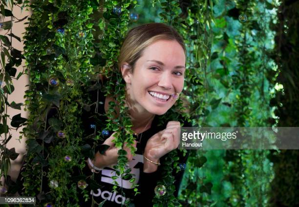 In this handout image provded by Tennis Australia Danielle Collins of the United States visits Garnier world on Grand Slam Oval during the 2019...