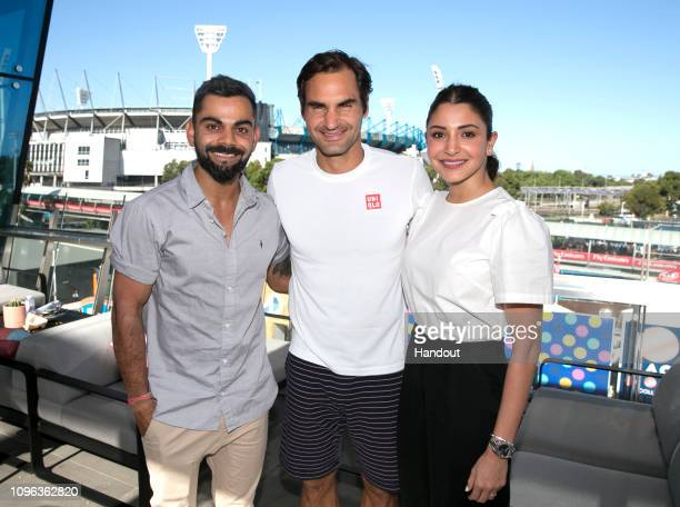 In this handout image provded by Tennis Australia Virat Kohli and wife Anushka Sharma meet with Roger Federer of Switzerland during the 2019...