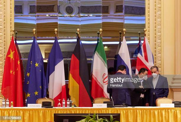 In this handout image provide by EU Delegation Vienna, Iranian Deputy Foreign Minister Abbas Araghchi speaks with other participants at the JCPOA...