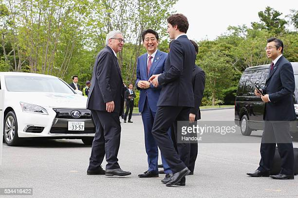 In this handout image provide by Foreign Ministry of Japan European Commission President JeanClaude Juncker Japanese Prime Minister Shinzo Abe and...