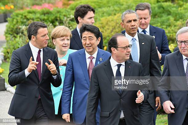 In this handout image provide by Foreign Ministry of Japan Italian Prime Minister Matteo Renzi German Chancellor Angela Merkel Canadian Prime...