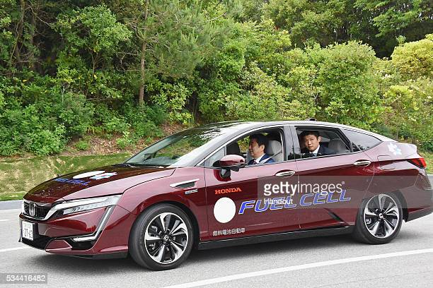 In this handout image provide by Foreign Ministry of Japan Japanese Prime Minister Shinzo Abe rides the automated driving vehicle during the...