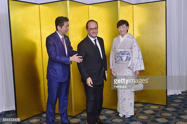 In this handout image provide by Foreign Ministry of Japan Japanese Prime Minister Shinzo Abe French President Francois Hollande and Akie Abe attend...