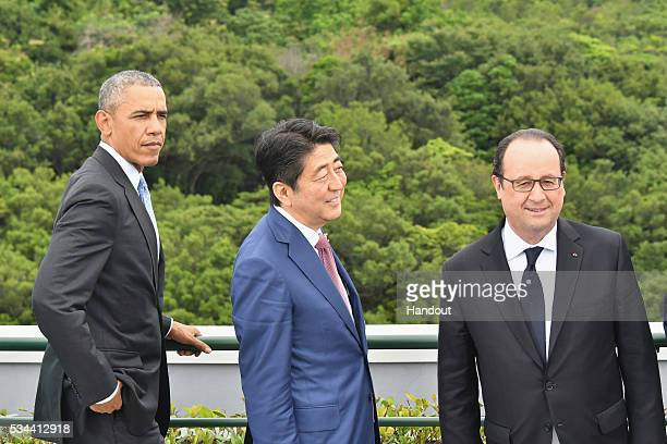 In this handout image provide by Foreign Ministry of Japan US President Barack Obama Japanese Prime Minister Shinzo Abe French President Francois...