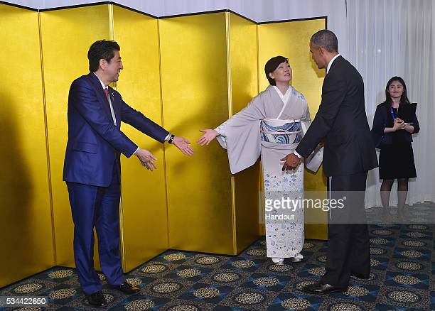 In this handout image provide by Foreign Ministry of Japan US President Barack Obama Japanese Prime Minister Shinzo Abe and wife Akie Abe attend the...