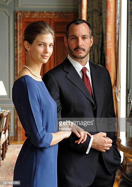 In this handout image provide by the Aga Khan Development Network Prince Rahim Aga Khan and his fiance Kendra Spears pose on April 15 2013 in France...