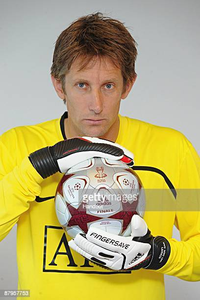 In this handout image provided by adidas Edwin van der Sar of Manchester United holds the adidas 'Finale Rome' official match ball prior to the UEFA...