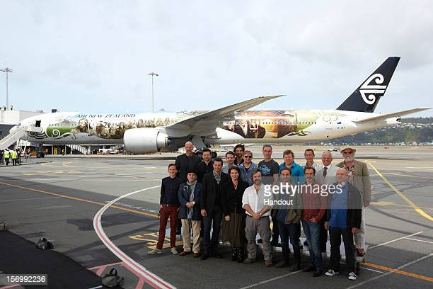 In this handout image provided by Air New Zealand, the cast and crew of 'The Hobbit: An Unexpected Journey', pose infront of an Air New Zealand...