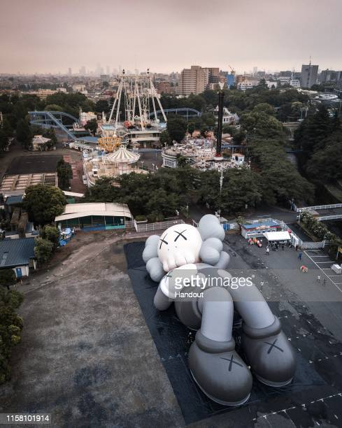 In this handout image provided by AllRightsReserved the inflatable test of KAWSHOLIDAY JAPAN is seen at Toshimaen on June 25 2019 in Tokyo Japan...