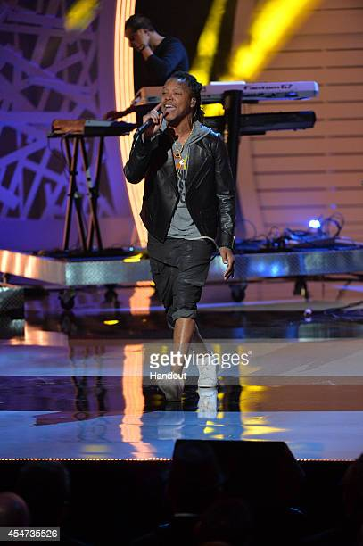 In this handout image provided by American Broadcasting Companies Inc Lupe Fiasco performs onstage during the 4th Biennial Stand Up To Cancer A...