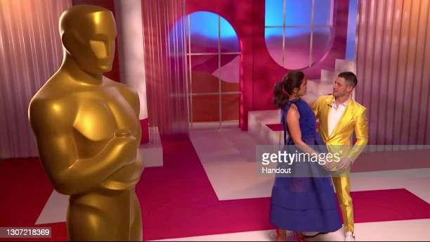 In this handout image provided by A.M.P.A.S. Priyanka Chopra Jonas and Nick Jonas embrace at the 93rd Academy Awards Nominations Announcement on...