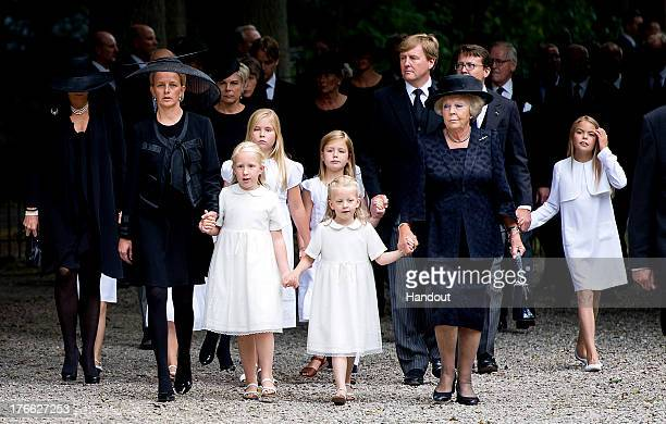 In this handout image provided by ANP, Princess Mabel of the Netherlands walks with her daughters Countess Luana and Countess Zaria of the...