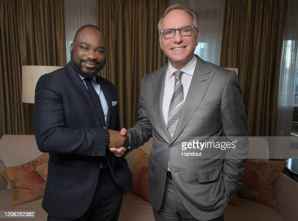 In this handout image provided by APO Group Alexander Amosu Founder and CEO of Lux Afrique with Lionel Reina CEO of APO Group at the Corinthia Hotel...