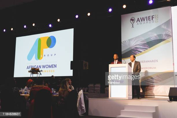 In this handout image provided by APO Group, Announcing the winner of the APO Group African Women in Media Award, Katlego Mabboe, AWIEF Awards MC,...