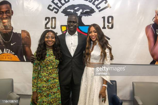 In this handout image provided by APO Group Journalist Benny Bonsu Naomi Campbell and Amadou Gallo Fall Founder of SEED NBA Vice President and...