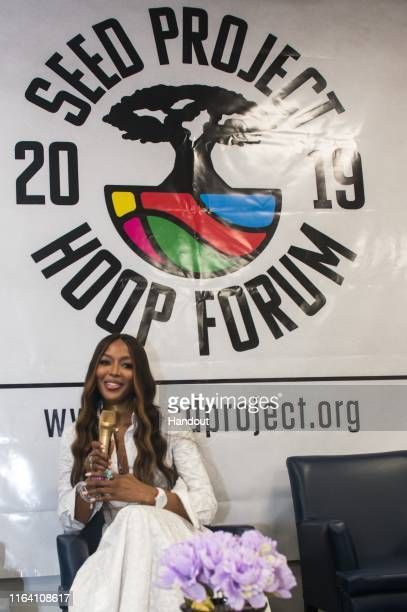 In this handout image provided by APO Group Naomi Campbell encourages and supports the female basketball players as they perfect their skills and use...