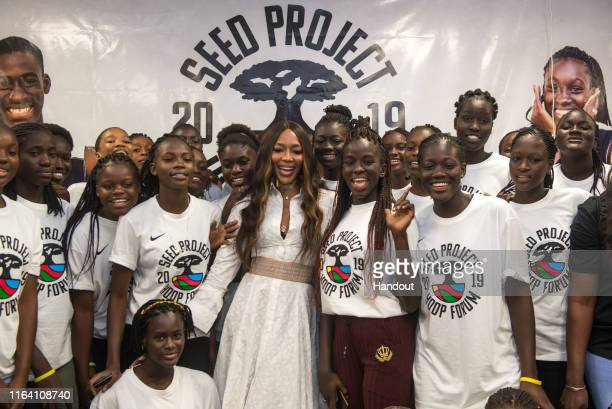 In this handout image provided by APO Group Naomi Campbell poses with female basketball players at the Hoop Forum organized by SEED on July 24 2019...