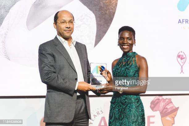 In this handout image provided by APO Group, Nila Yasmin, APO Group African Women in Media Award Winner receiving the APO Group African Women in...