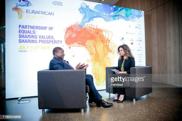 In this handout image provided by APO Group President of the Republic of Mozambique Filipe Nyusi is interviewed by Euronews during the EurAfrican...