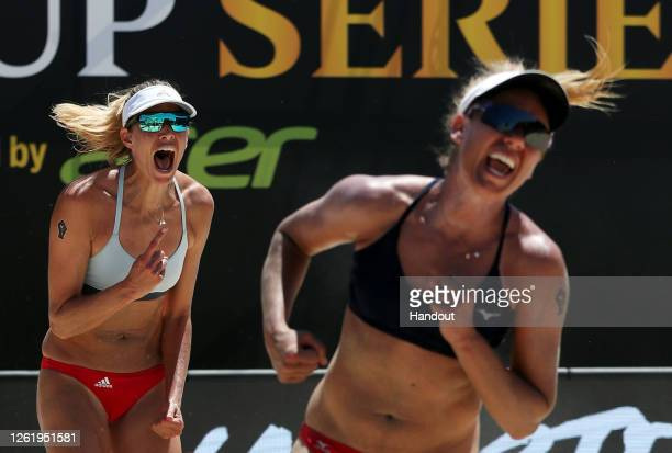 In this handout image provided by AVP, Alix Klineman and April Ross celebrate against Melissa Humana-Paredes and Sarah Pavan in the final during the...