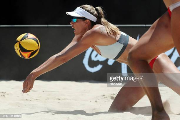 In this handout image provided by AVP, Alix Klineman competes against Melissa Humana-Paredes and Sarah Pavan in the final during the Wilson Cup on...