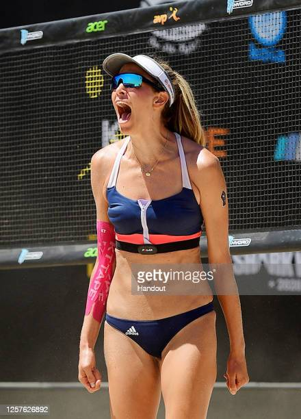 In this handout image provided by AVP, Alix Klineman reacts against Sarah Pavan and Melissa Humana-Paredes in the semifinals during the Monster Hydro...