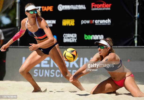 In this handout image provided by AVP, April Ross and Alix Klineman compete against Sarah Pavan and Melissa Humana-Paredes in the semifinals during...