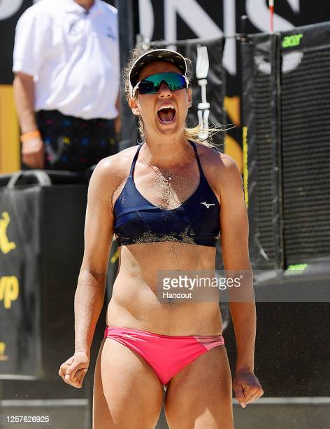 In this handout image provided by AVP, April Ross reacts against Sarah Pavan and Melissa Humana-Paredes in the semifinals during the Monster Hydro...
