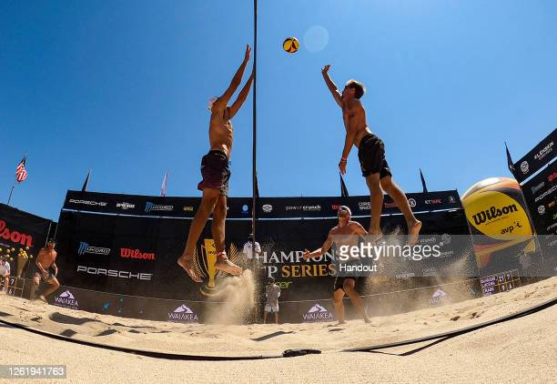 In this handout image provided by AVP, Jake Gibb and Taylor Crabb compete against Nick Lucena and Phil Dalhausser in the final during the Wilson Cup...