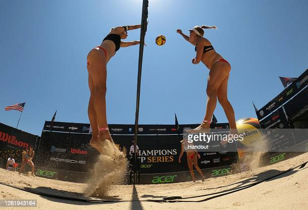 In this handout image provided by AVP, Melissa Humana-Paredes and Sarah Pavan compete against Alix Klineman and April Ross in the final during the...