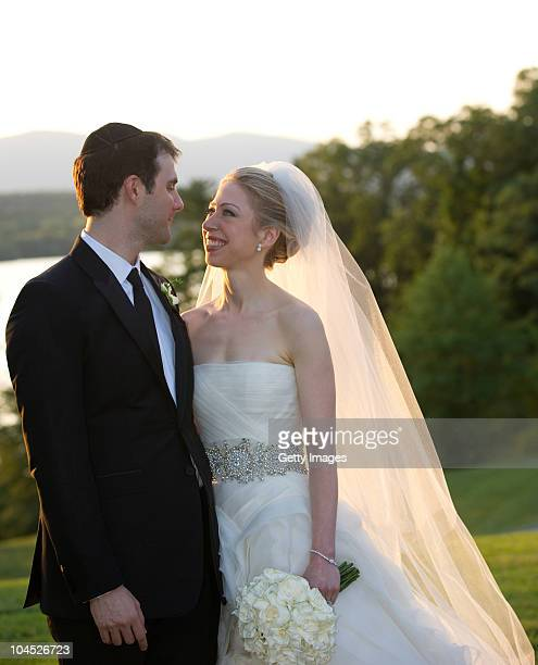 In this handout image provided by Barbara Kinney Marc Mezvinsky and Chelsea Clinton pose during their wedding at the Astor Courts Estate on July 31...