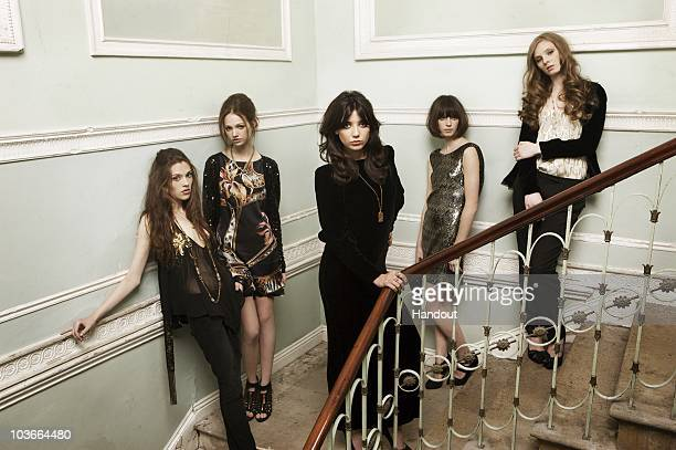 In this handout image provided by BIBA Daisy Lowe poses with models as the new face of BIBA for their Autumn Winter collection of womenswear and...