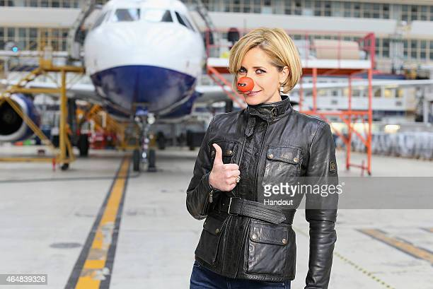 In this handout image provided by British Airways Darcey Bussell poses wearing a Comic Relief Red nose before directing British Airways colleagues as...