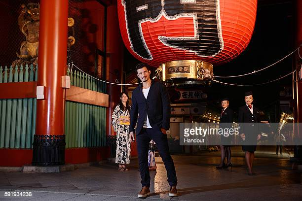 In this handout image provided by British Airways Orlando Bloom is seen posing in front of iconic Kaminarimon with British Airways Ambassadors on...