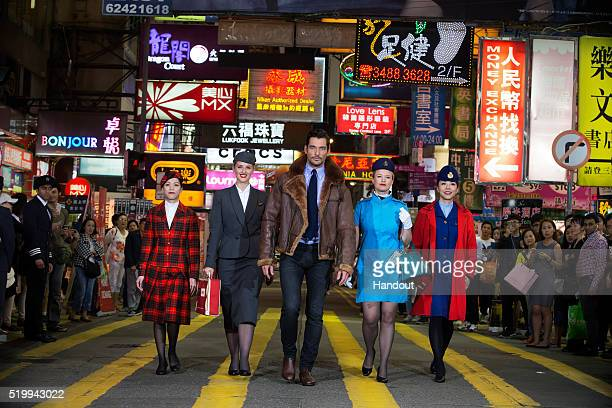 In this handout image provided by British Airways Supermodel David Gandy takes part in an impromptu British Airways heritage fashion show on the...