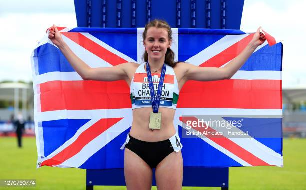 In this handout image provided by British Athletics, Gold Medalist, Keely Hodgkinson of Great Britain poses during the medal ceremony for the Women's...