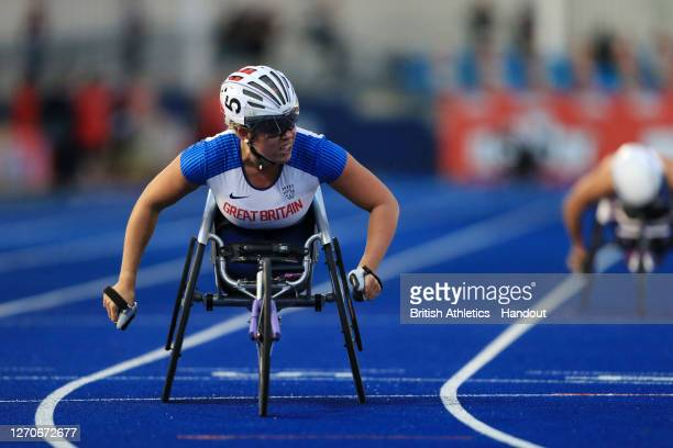 In this handout image provided by British Athletics, Hannah Cockroft of Great Britain takes part in the Women's 400 Metres Wheelchair Race during day...