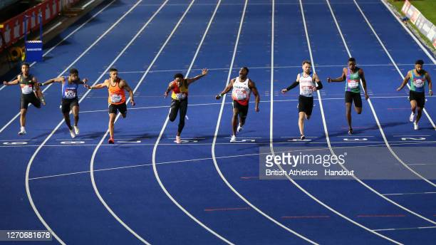 In this handout image provided by British Athletics, Harry Aikines-Aryeetey of Great Britain crosses the finish line to win Men's 100 Metres during...