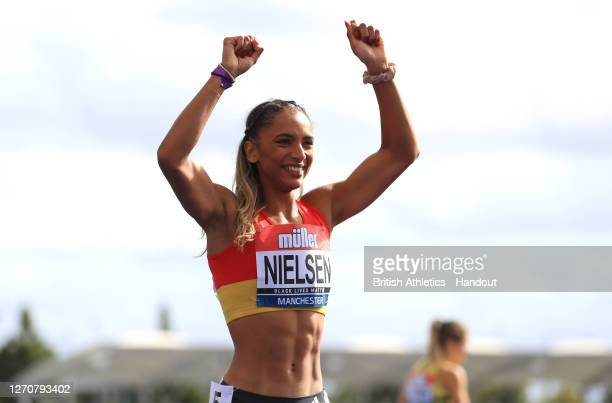 In this handout image provided by British Athletics, Laviai Nielsen of Great Britain celebrates winning the Women's 400 Metres during Day Two of the...