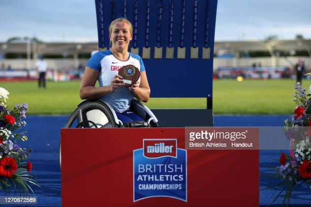 In this handout image provided by British Athletics, Race Winner, Hannah Cockroft of Great Britain poses with her first place trophy for the Women's...