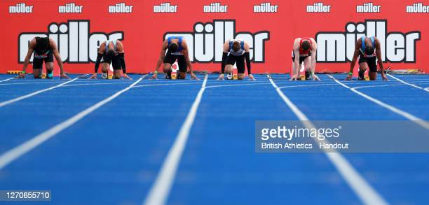 In this handout image provided by British Athletics, runners prepare ahead of the Men's 100 Metres during day one of Muller British Athletics...