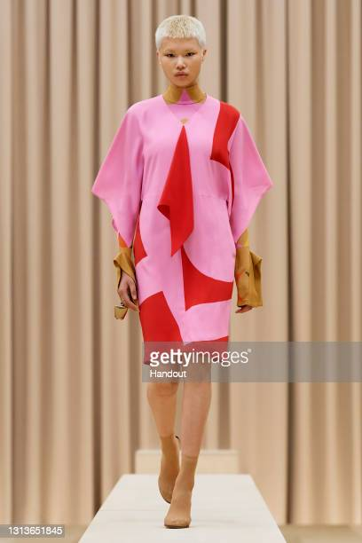 In this handout image provided by Burberry, a model walks the runway during the Burberry Autumn/Winter 2021 Womenswear presentation on April 21, 2021...